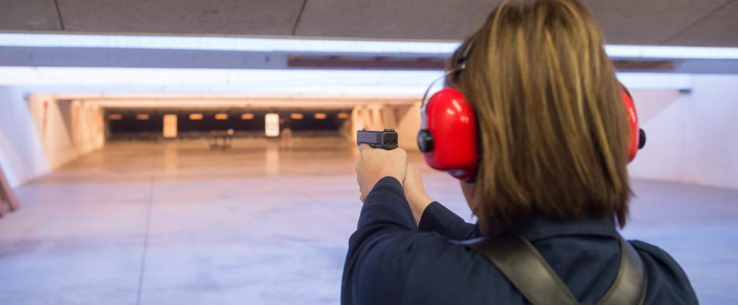 Female officer practicing on the shooting range