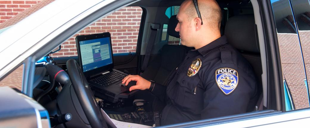 Officer on his computer
